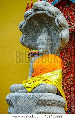 Buddha Image statue covering with Naga head