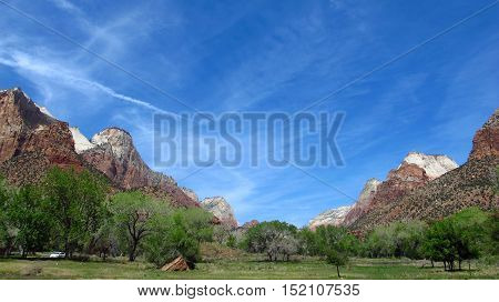 Panoramic view of Zion Park, Utah, United States, with colorful mountains and wild nature. Light and natural colors.