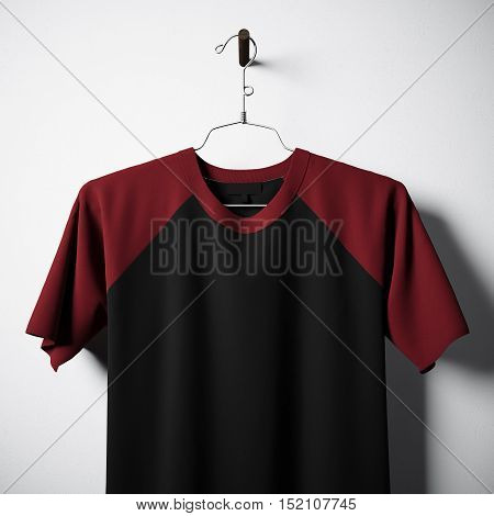 Closeup of blank cotton tshirt, black and red colors hanging in center empty concrete wall. Clear label mockup with highly detailed textured materials. Square. Front side view. 3D rendering