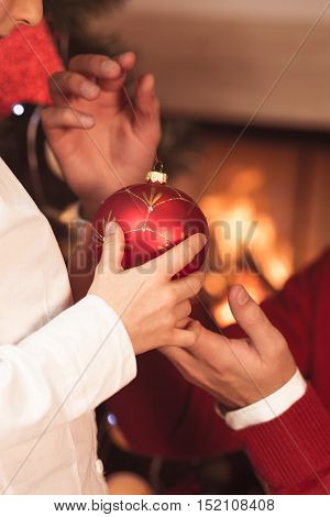 Child holding red bauble - Christmas tree decoration