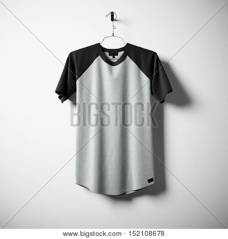 Blank cotton tshirt of gray and black colors hanging in center empty concrete wall. Clear label mockup with highly detailed texture materials. Square. Front side view. 3D rendering