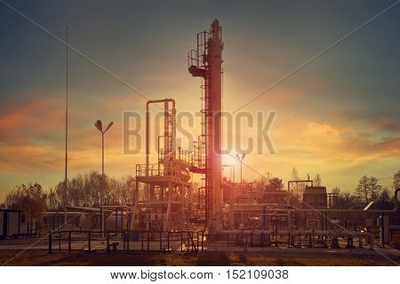 Natural gas compression processing plant for dehydration at sunset with beautiful color sky