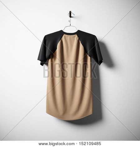 Blank cotton tshirt of brown color hanging in center of empty concrete wall. Clear label mockup with highly detailed texture materials. Square. Back side view. 3D rendering