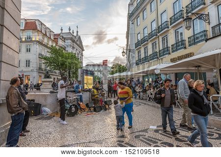 Group Of  Unidentified Street Musicians Play Songs In Lisbon