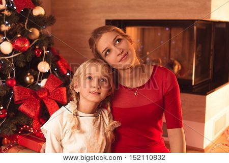 Image of mother and daughter enjoying Christmas time