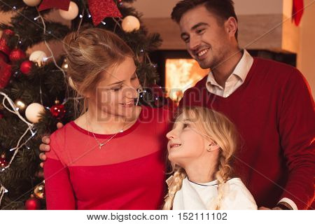 Happy smiling family spending Christmas at home