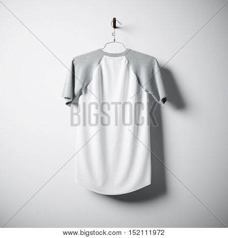 Blank cotton tshirt of white and gray colors hanging in center empty concrete wall. Clear label mockup with highly detailed textured materials. Square. Back side view. 3D rendering