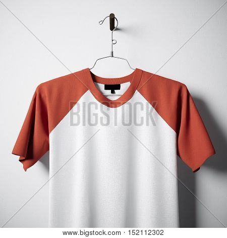 Closeup of blank white and orange cotton tshirt hanging in center of empty concrete wall. Clear label mockup with highly detailed textured materials. Square. Front side view. 3D rendering