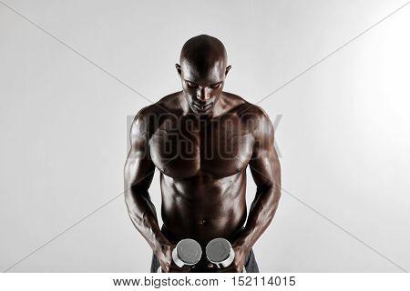 African Man Holding Dumbbells