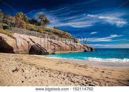 beautiful tropical sandy beach Playa Del Duque in Costa Adeje Tenerife Canary Islands