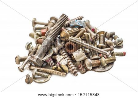 Pile of old screws and nuts on a white background. Pile of old screws and nuts isolated.