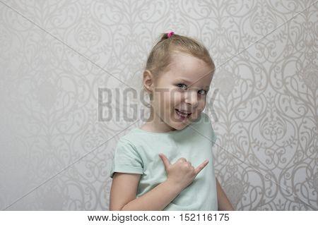 Beautiful little girl gesturing studio cropped shot