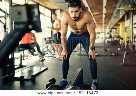 Determined and focused handsome bodybuilder in gym