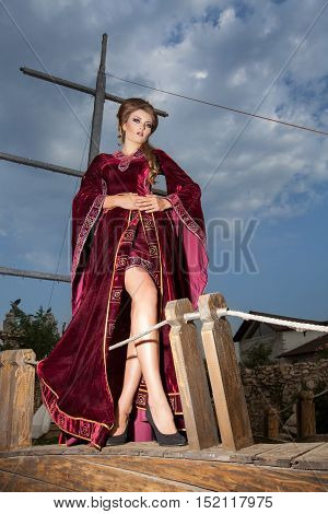 Gorgeous Woman In Old Fashion Clothes On A Boat