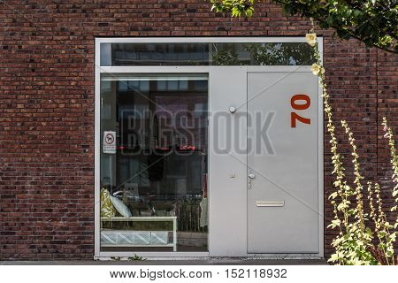 Amsterdam Netherlands - August 08 2016: Door in modern architecture house. Ijburg is a residential neighbourhood in artificial islands east of Amsterdam which combines modern architecture water nature good restaurants and hip shops.