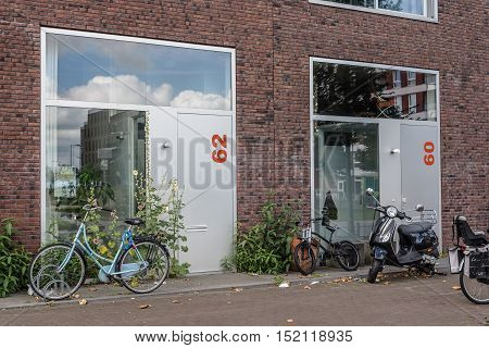 Amsterdam Netherlands - August 08 2016: Row modern architecture houses. Ijburg is a residential neighbourhood in artificial islands east of Amsterdam which combines modern architecture water nature good restaurants and hip shops.