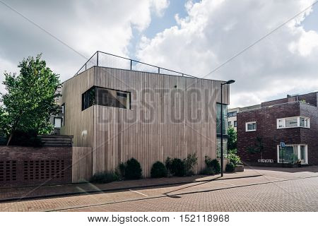 Amsterdam Netherlands - August 08 2016: Modern architecture wooden house. Ijburg is a residential neighbourhood in artificial islands east of Amsterdam which combines modern architecture water nature good restaurants and hip shops.