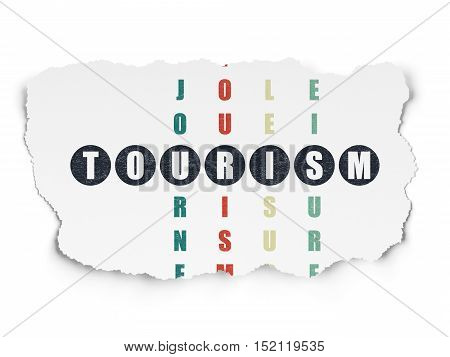 Travel concept: Painted black word Tourism in solving Crossword Puzzle on Torn Paper background