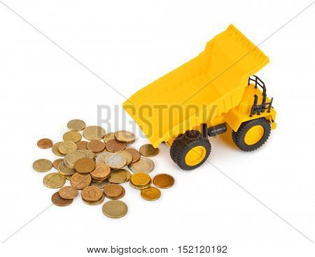 Toy car truck and money coins isolated on white background
