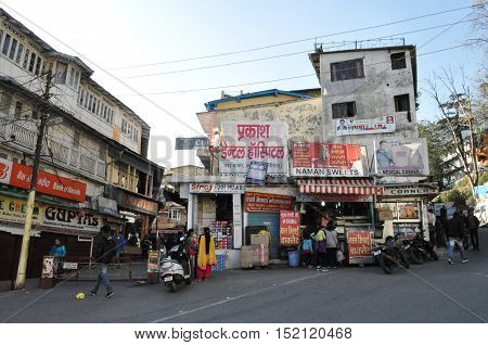 November 13, 2015: Market place famous for candles, woolen cloths, fruits and handicrafts at Mallital, Nainital, Uttarakhand, India. Nainital is a popular hill station in Uttarakhand, named after the Goddess Naina Devi. It also known as the 'Gateway to Ku