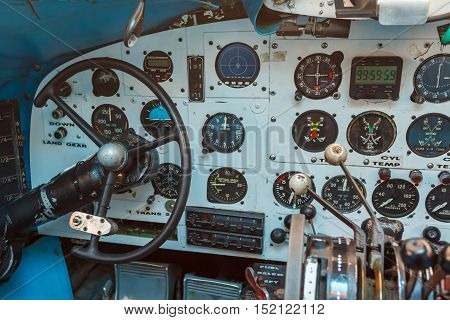 Engine Controls and other devices in the cockpit of an old airplane