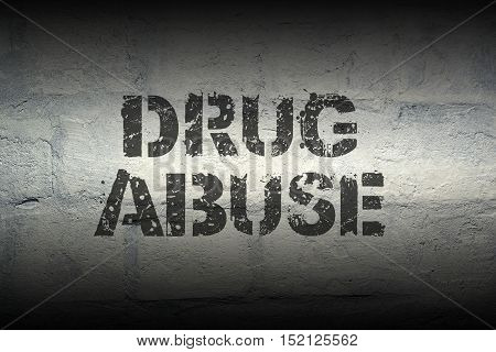 drug abuse stencil print on the grunge white brick wall; specially designed font is used