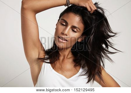 Spanish Woman With Closed Eyes Touching Her Hair