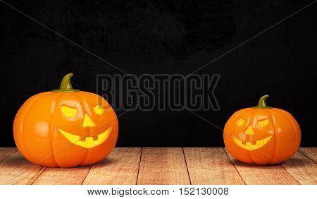 Halloween pumpkin on wooden table on dark background. 3d rendering