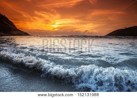 Beautiful sunset with orange sky over blue sea