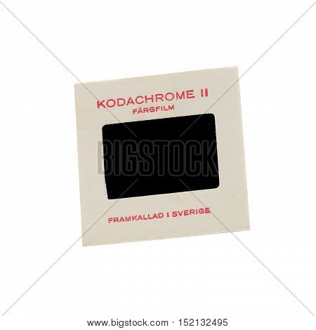 Stockholm, Sweden - March 20, 2016: A Kodak Kodachrome II slide in cardboard frame with color film developed in Sweden in the early 1960s isolated on white background.
