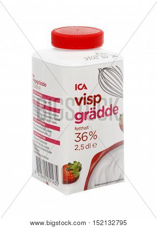 Stockholm, Sweden - Mars 20 2016: A pack ICA brand whipping cream 36% 25 dl for the Swedish market isolated on white background.