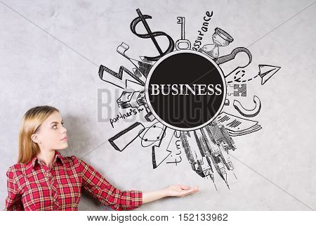 Young woman presenting creative business sketch on concrete background. Success concept