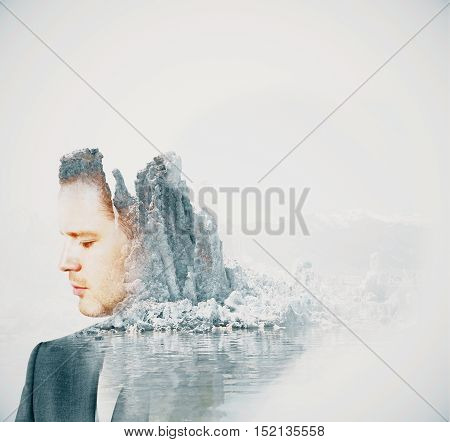 Side view of handsome young businessman on abstract snowy landscape background with copy space. Double exposure