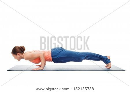 Woman doing Ashtanga Vinyasa Yoga asana Chaturanga Dandasana - four-limbed staff pose posture isolated on white background