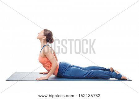 Woman doing Hatha yoga asana Bhujangasana - cobra pose posture isolated on white background background