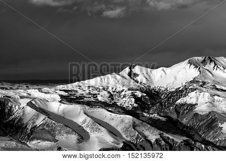 Black And White Winter Mountains At Sun Evening And Dark Clouds