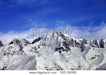 Snow Mountains In Winter Sun Day And Blue Sky With Clouds