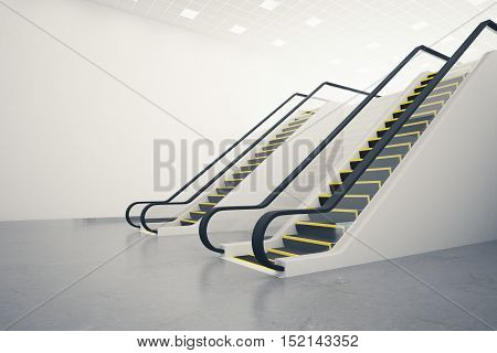 Side view of two escalators in concrete room with blank wall. Mock up 3D Rendering