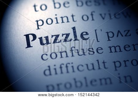 Fake Dictionary definition of the word puzzle.