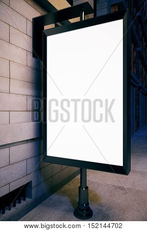 Closeup of blank ad poster outside next to concrete tile building. Mock up 3D Rendering. Advertisement concept