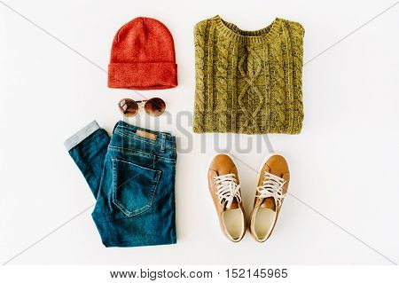 woman autumn and winter clothes collage on white flat lay top view