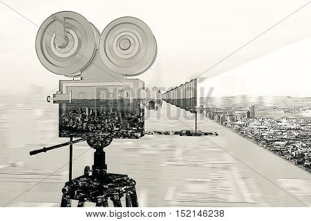 Old movie camera on abstract city background. Double exposure. Cinema concept. Retro filter