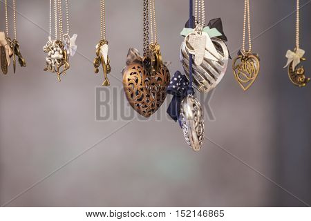 Set of different shape pendants made of metal shape of heart