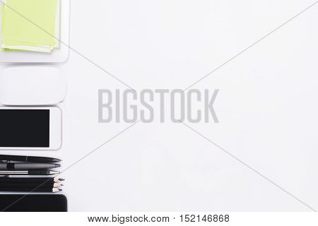 Top view of white desktop with electronic devices supplies and copy space