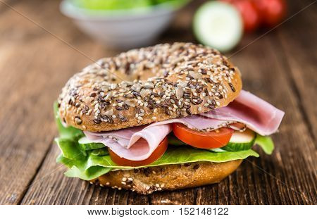 Wooden Table With Ham Bagel (selective Focus)