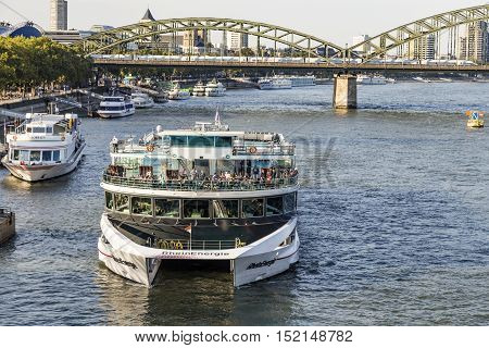 COLOGNE GERMANY - SEP 21 2016: people enjoy the cruise on river Rhine in late afternoon