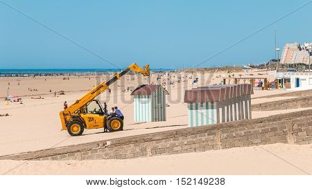 Dismantling Beach Huts At The End Of The Summer Season