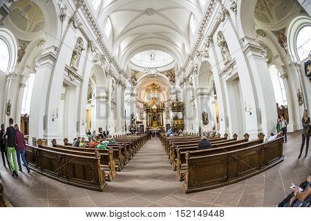 FULDA GERMANY - SEP 20. 2014: people inside of baroque Cathedral in Fulda Germany. Fulda Cathedral is the former abbey church of Fulda Abbey and the burial place of Saint Boniface.