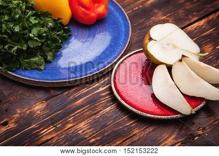Sliced Pears On A Ceramic Plate On The Background Of Old Boards