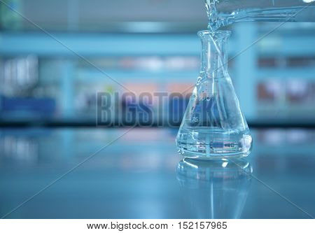 water poring in the flask at lab science background